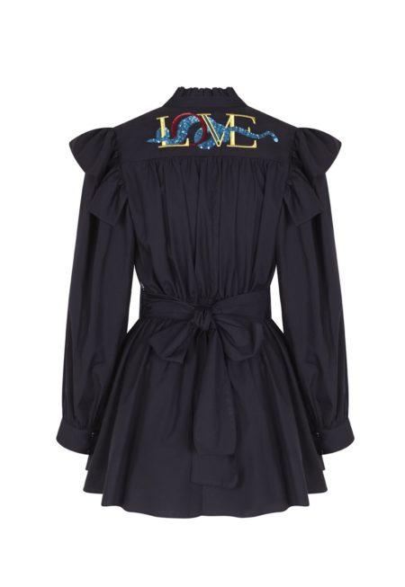 Guts and love. Parte de atrás del vestido corto de color negro Love jumpsuit de la colección primavera verano 2020 Underneath the star